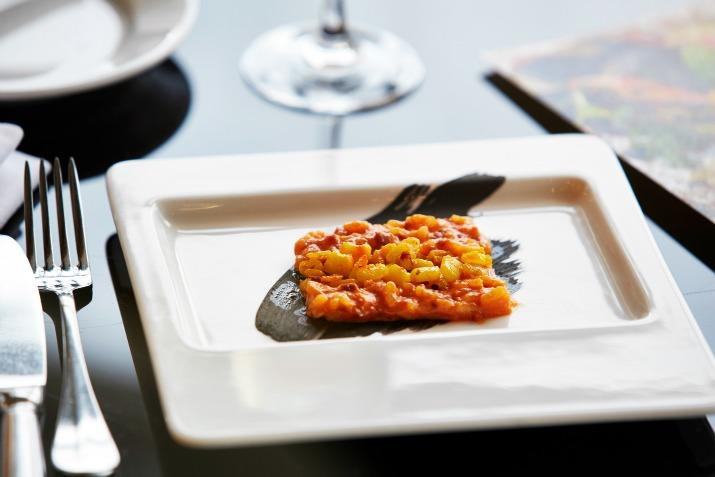 Red pepper & chorizo risotto, saffron, squid Art of style event harvey nichols